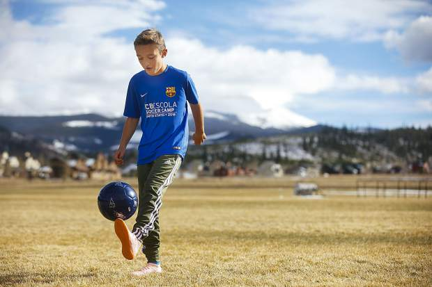Summit Middle School sixth-grade student Nico Novotny, 11, dribbles a soccer ball at the field at Summit High School while wearing his FC Barcelona camp gear on Friday in Breckenridge.