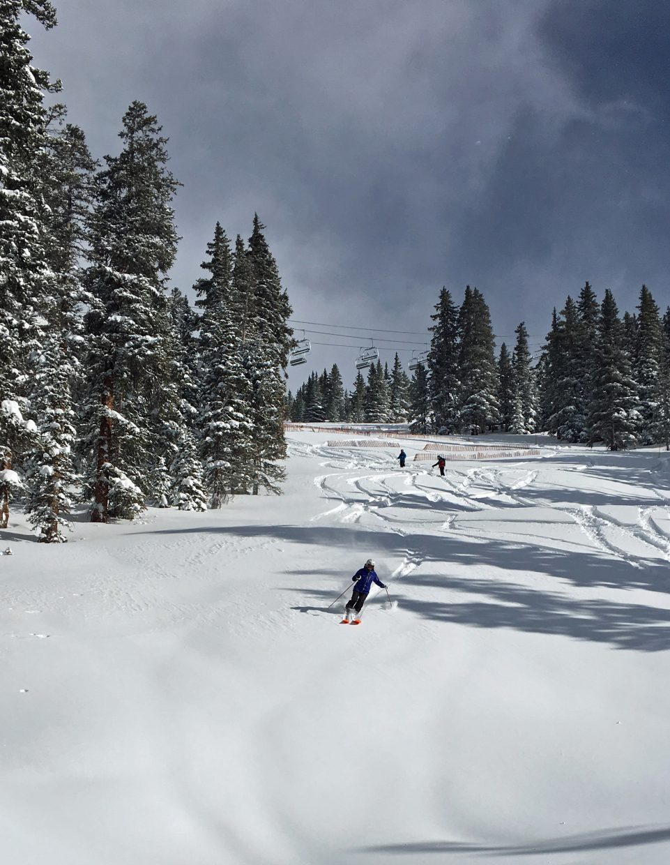 Skiers carve turns in fresh powder in the terrain expansion at Arapahoe Basin Ski Area on Sunday, a day before A-Basin is scheduled to open lift-service in its newest terrain expansion on Monday.