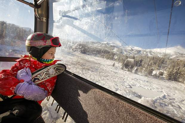 Inara Postier, 8, rides the gondola to the Peak 8 base area for Breckenridge Ski Resort's opening day on Wednesday Nov. 7, in Breckenridge. Inara skipped school and commuted to Breckenridge from Colorado Springs with her father to ski.