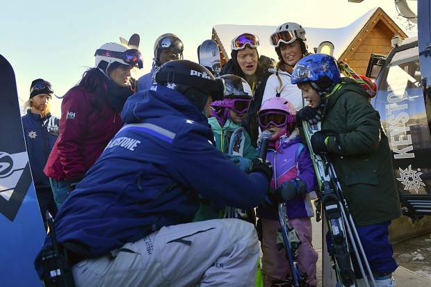 Young skiers and riders count down the seconds to the official opening of Keystone Resort before boarding the River Run Gondola for their first runs of the 2018-19 ski season at Keystone on Wednesday.