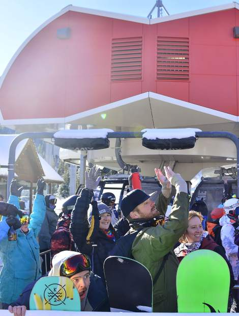 Opening day skiers and riders prepare for a T-shirt cannon to fire Wednesday morning at Keystone Resort.