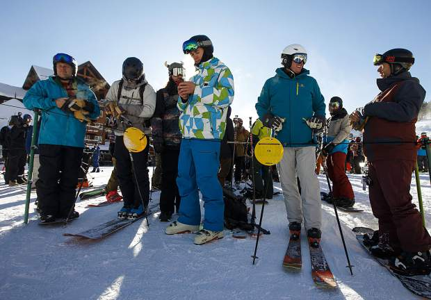 Skiers and snowboarders line up for first chair at Breckenridge Ski Resort on Wednesday Nov. 7, in Breckenridge. They arrived around 6 a.m. to be first in line at the Colorado SuperChair.