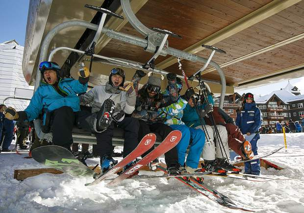 Skiers and snowboarders ride the first chair at Breckenridge Ski Resort on Wednesday Nov. 7, in Breckenridge. They arrived around 6 a.m. to be first in line at the Colorado SuperChair.