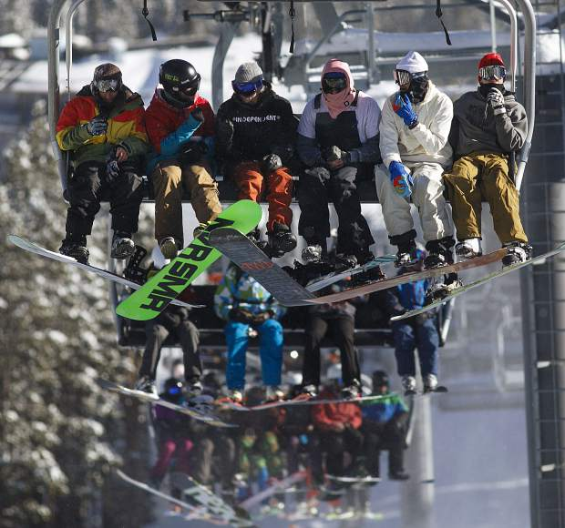 Skiers and snowboarders ride on the Colorado SuperChair at Breckenridge Ski Resort on Wednesday, Nov. 7, in Breckenridge.
