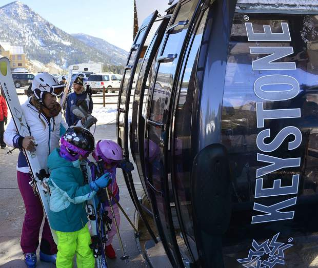 The first groups of skiers and riders board the River Run Gondola at Keystone Resort during Keystone's opening day on Wednesday morning.