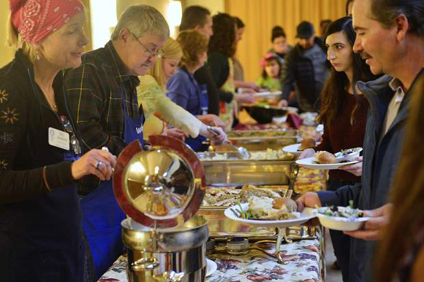 Rotarians serve members of the community a free meal on Thursday during the Summit County Rotary Community Thanksgiving Dinner at the Silverthorne Pavilion.