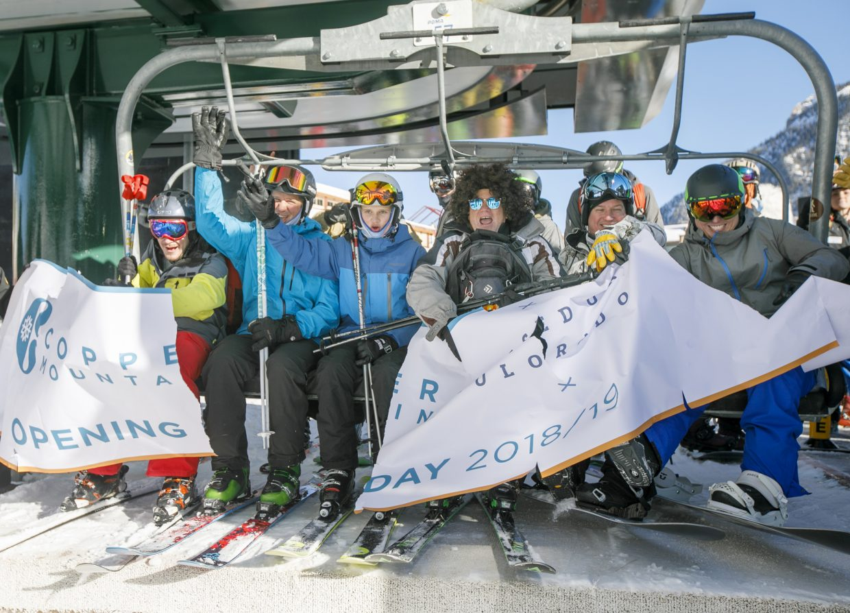 First chairlift riders of the 2018-2019 ski season tear through the banner Friday, Nov. 16, in Copper Mountain's East Village.