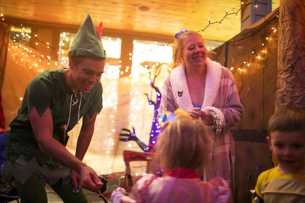 Ken Dixen, as Peter Pan, and Jessi Garhart as Wendy hand out candy for trick or treaters along Main Street Wednesday, Oct. 31, in Frisco.