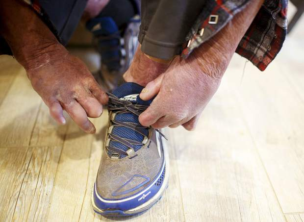 Former Flight For Life nurse Dave Repsher ties his shoes with effort Saturday, Nov. 17, at home in Silverthorne. Dave sustained full-thickness burns on 90 percent of his body in a July 2015 Flight for Life helicopter crash. Coming home was a major step for Repsher as he tries to reclaim pieces of his life lost in a July 2015 helicopter crash in Frisco.