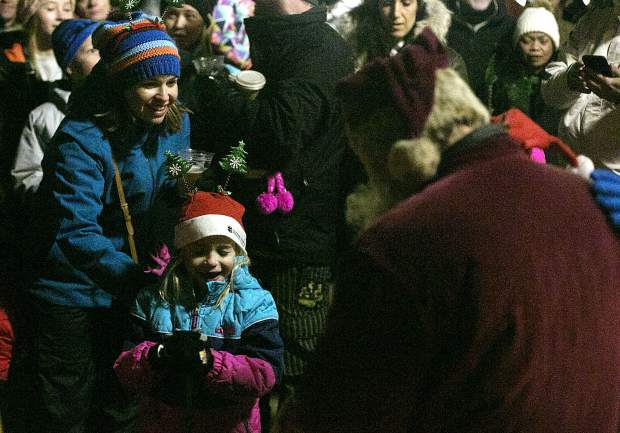 A young wisher reacts after speaking with Santa Claus at the Burning Stones Plaza in Center Village Friday, Nov. 23, at Copper Mountain.