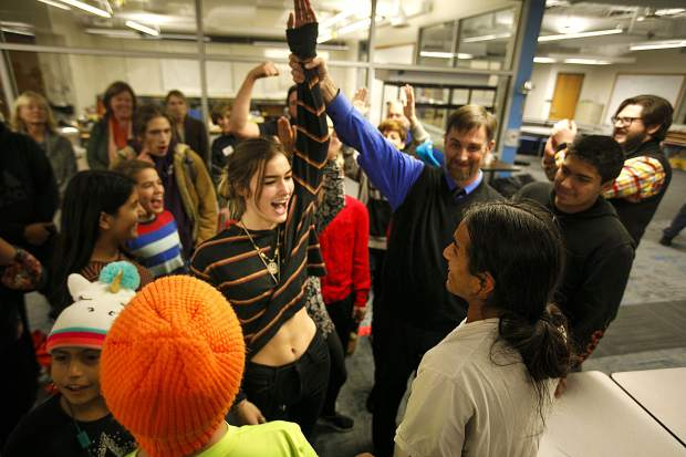 Snowy Peaks High School students celebrate with the winner of the rock-paper-scissors competition before the ribbon cutting ceremony Wednesday, Nov. 14, in Frisco.