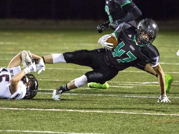 Summit High School senior wide receiver Angel Arrendondo is tackled during the Tigers' Senior Night loss to Palisade Friday night at Tiger Stadium in Breckenridge.