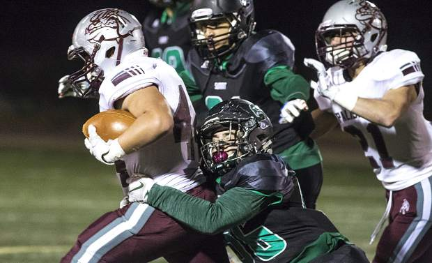 The Summit High School defense tackles Palisade during Friday night's home loss at Tiger Stadium in Breckenridge.