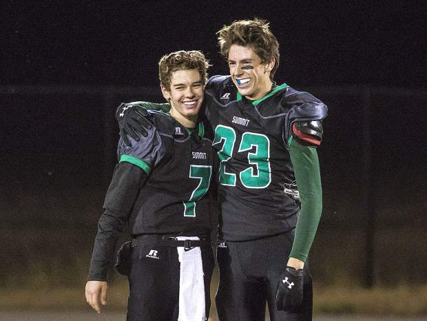Summit High School senior quarterback Brendan Collins, left, and senior wide receiver Max Duxbury embrace during the program's senior night ceremony at halftime of Friday night's loss to Palisade at Tiger Stadium in Breckenridge.