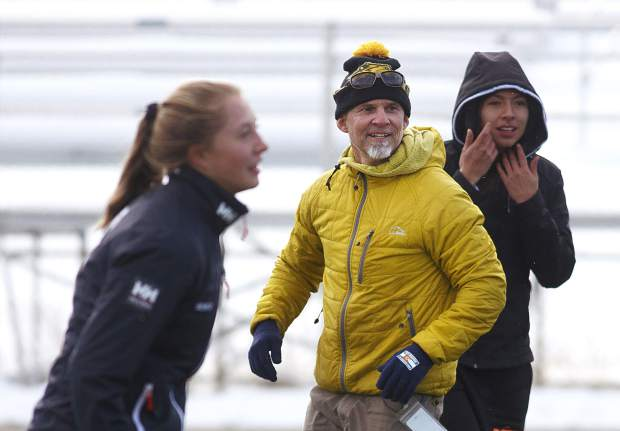 The Summit High School girls rugby team and head coach Karl Barth practice outside at Summit High School despite the cold conditions during practice on Thursday, Nov. 8, at Tiger Stadium in Breckenridge.
