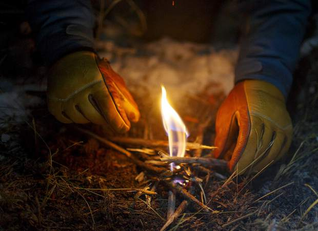 A fire is lit by a volunteer recruit for the Summit County Rescue Group during survival training Thursday night, Nov. 8, on the Frisco Peninsula.