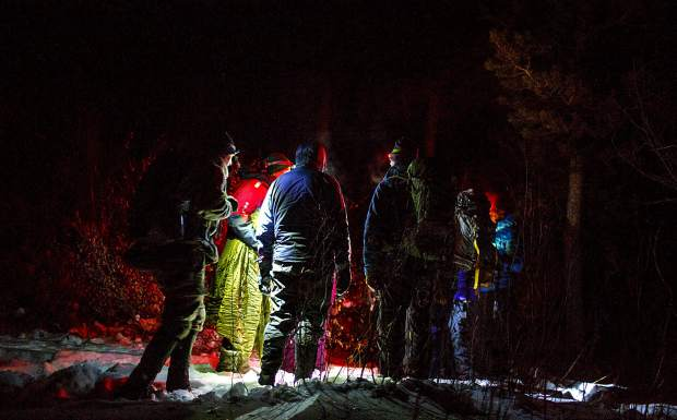 Volunteers for the Summit County Rescue Group gather during survival training Thursday night, Nov. 8, on the Frisco Peninsula.