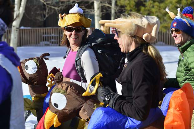 Costumed runners take off Thursday during the sixth annual Turkey Day 5k Fun Run in Frisco benefitting Frisco Elementary School.