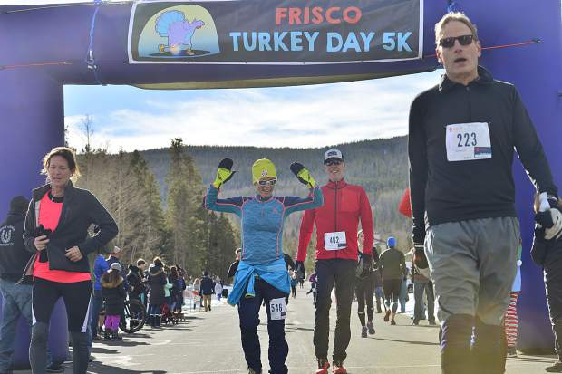 Runners cross the finish line for the sixth annual Turkey Day 5k Fun Run in Frisco on Thanksgiving.