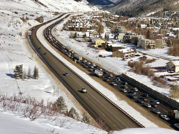 Eastbound traffic on Interstate 70 is slow-going Sunday after weekend snowstorm caused a 20-car pileup that shutdown the interstate for six hours on Saturday, leading officials to open Summit Middle School in Frisco as an emergency shelter for stranded motorists.