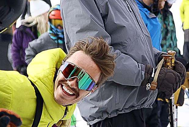 A skier laughs in the Ajax Express lift line for opening day on Saturday at Aspen Mountain.