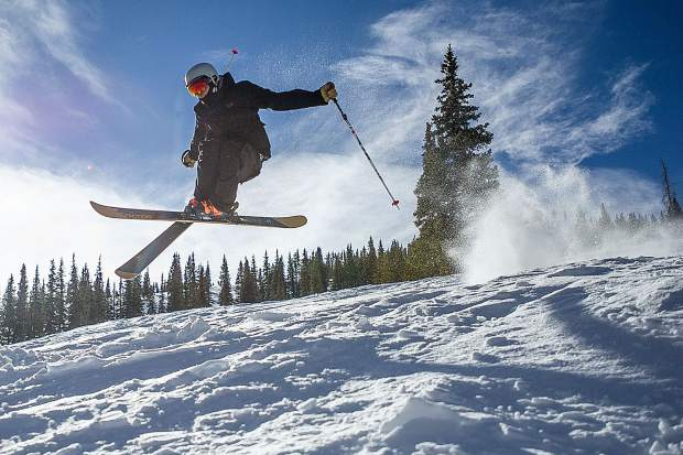 Bear Bolduc gets some air on Snowmass Mountain for opening day Thursday.