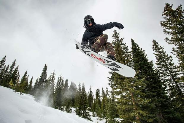 Ben Sydoryk does a tail grab off of a jump on Snowmass Mountain on opening day Thursday.