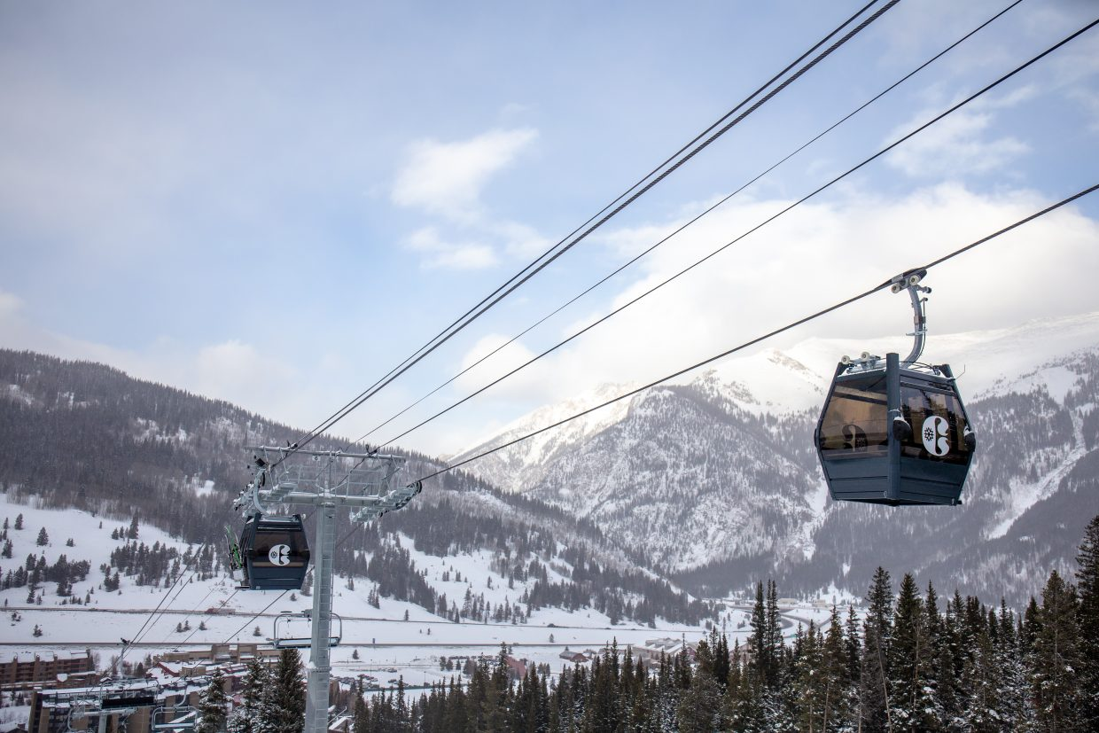 The new gondola cabins for Copper Mountain Resort's new American Eagle chairlift operate at the resort on Monday, with the TenMile Range in view at rear.
