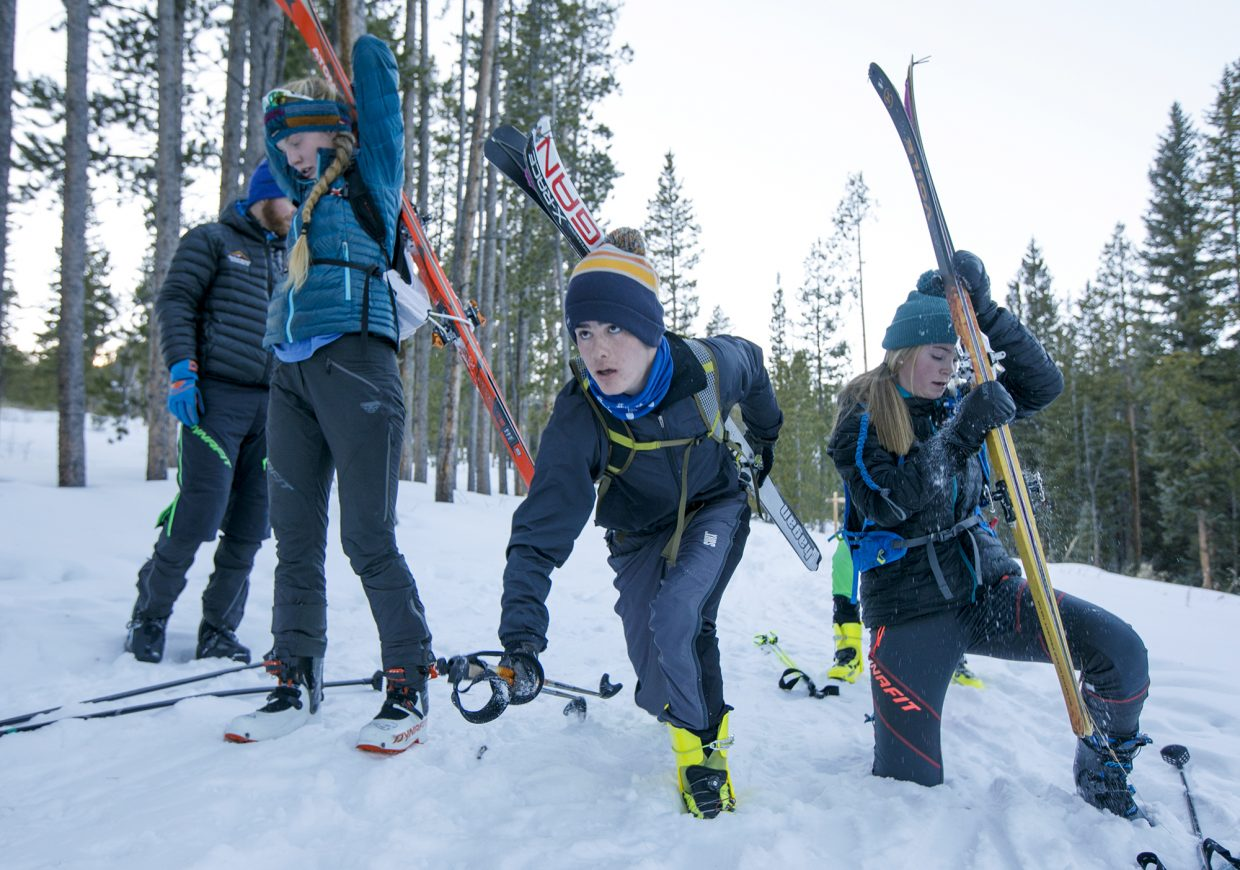 Cadet ski mountaineering athletes, ages 15-17, from left, Grace Staberg, Mark Jardim, and Elsa Bates transition from skinning to boot packing during practice Tuesday, Dec. 11, in Breckenridge.