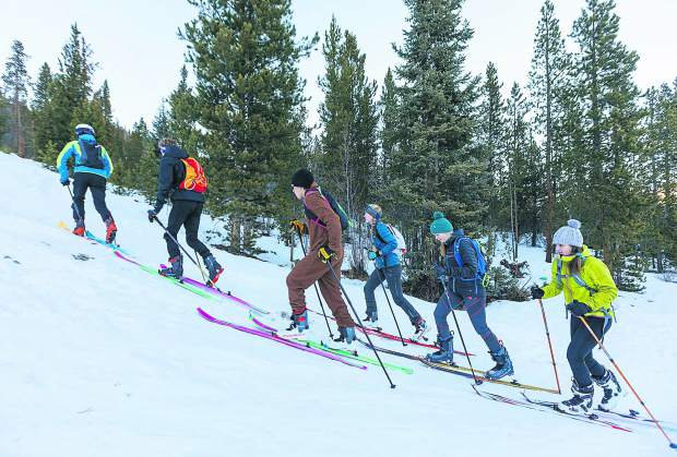 Cadet and junior ski mountaineering athletes skin uphill during practice on Tuesday, Dec. 11, in Breckenridge.
