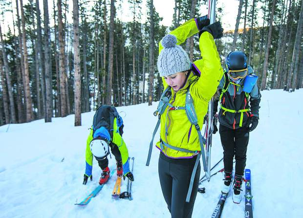 Cadet and junior ski mountaineering athletes Finn Remias far left, Cam Gallen, and Dylan Parmley, far right, transition to skins after boot-packing uphill during practice on Tuesday, Dec. 11, in Breckenridge.