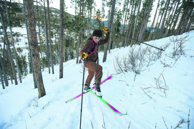 Cadet ski mountaineering athlete Korben Long makes a kick-turn while skinning uphill during practice on Tuesday, Dec. 11, in Breckenridge.