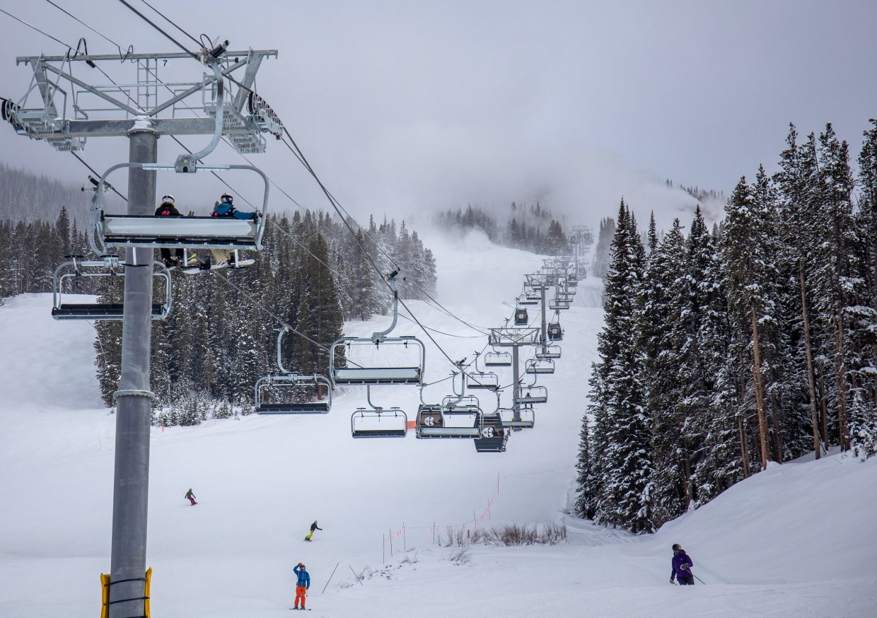 Skiers and riders ascend Copper Mountain Resort via the new gondola cabins and chairs for the resort's new American Eagle chairlift on Monday.
