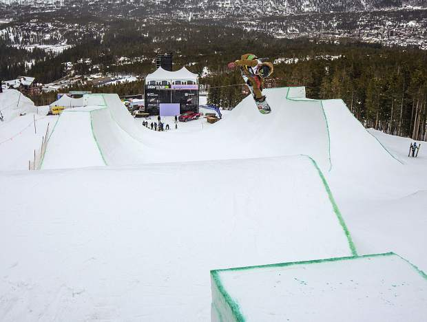 A snowboarder drops in to the modified superpipe during practice on Wednesday, Dec. 12, ahead of this week's Dew Tour event at Breckenridge Ski Resort.