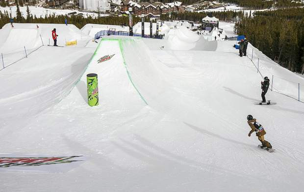A snowboarder drops into the side hit at the top of the modified superpipe during practice ahead of this week's Dew Tour event on Wednesday, Dec. 12, at Breckenridge Ski Resort.