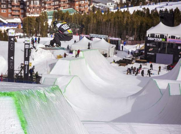 Snowboarder Stale Sandbech of Norway drops into the modified superpipe during practice on Wednesday, Dec. 12, at Breckenridge Ski Resort, ahead of Dew Tour competition, which begins Thursday and runs through Sunday.