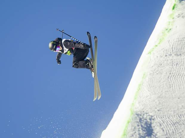 Canadian Rachel Karker executes a trick in midair at the Dew Tour ski superpipe women's finals on Friday, Dec. 14, at Breckenridge Ski Resort. Karker placed first.