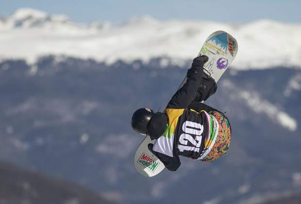 Julia Marino, of Connecticut, executes a trick in midair at the Dew Tour snowboard slopestyle women's finals on Friday, Dec. 14, at Breckenridge Ski Resort. Marino place second overall, the highest of any American.