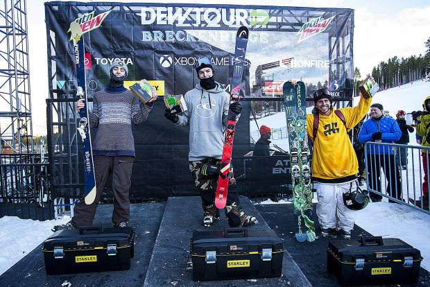 From left to right, Alex Hall of Alaska, Evan McEachran of Canada, and Henrik Harlaut of Sweden take to the podium following the men's superpipe snowboard competition at Dew Tour on Saturday, Dec. 15, at Breckenridge Ski Resort.