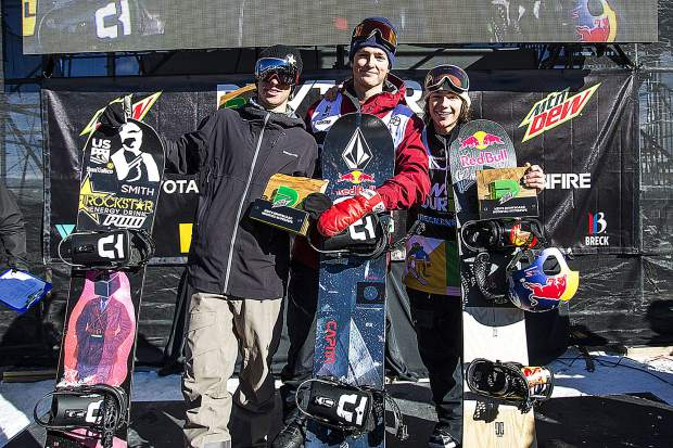 From left to right, Chase Josey of Idaho, Scotty James of Australia, and Toby Miller of California take to the podium following the men's snowboard modified superpipe competition at Dew Tour on Saturday, Dec. 15, at Breckenridge Ski Resort.