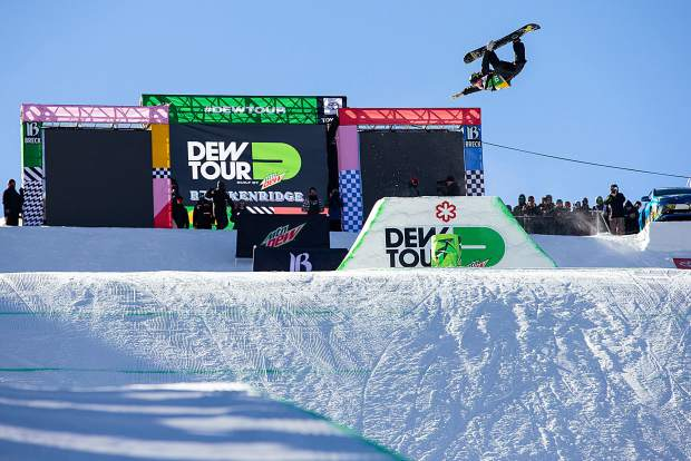 Jake Pates of Eagle tweaks out a grab on the first feature of the Dew Tour modified halfpipe competition on Saturday, Dec. 15, at Breckenridge Ski Resort.