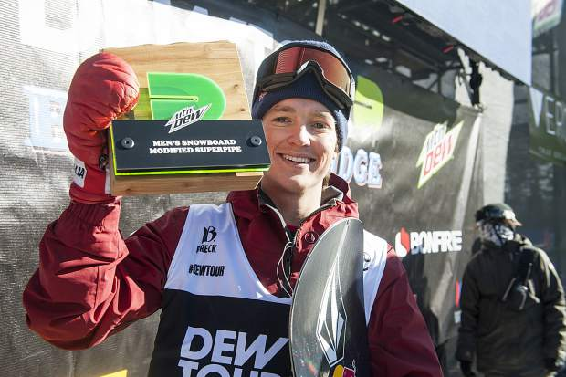 Scotty James of Australia celebrates with the first-place trophy following the men's snowboard modified superpipe competition at Dew Tour on Saturday, Dec. 15, at Breckenridge Ski Resort.