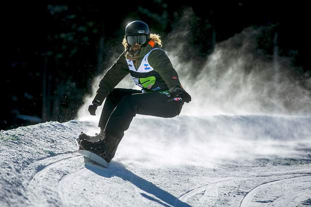 Daniel Strausbaugh races down the course during the Dew Tour adaptive snowboard banked slalom men's finals Thursday, Dec. 13, at Breckenridge Ski Resort, CO. The former Navy pilot had his right hand amputated due to a tumor.