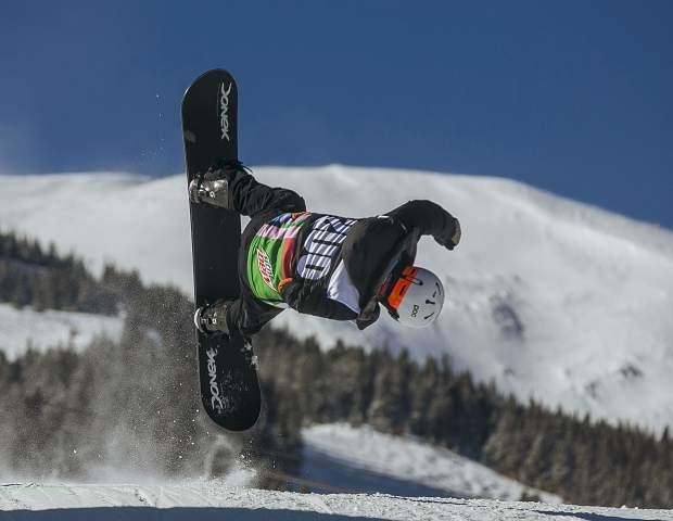 Paralympian gold medalist Mike Minor, of Frisco, with a missing arm, does a front flip while racing down the course during the Dew Tour adaptive snowboard cross men's finals Thursday, Dec. 13, at Breckenridge Ski Resort.