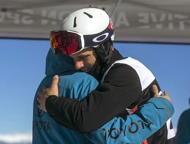 U.S. two-time paralympian medalist Evan Strong hugs a colleague ahead of his final run during the Dew Tour adaptive snowboard cross men's finals Thursday, Dec. 13, at Breckenridge Ski Resort. Strong, who lost his left leg in a motorcycle accident caused by a drunk driver, placed first in the event.