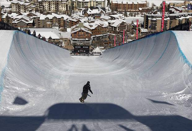 A snowboarder enters the halfpipe during training for the Toyota U.S. Grand Prix World Cup event on Tuesday, Dec. 4, at Copper Mountain Resort. Snowboard qualification rounds will take place on Thursday, with the finals scheduled for Saturday.