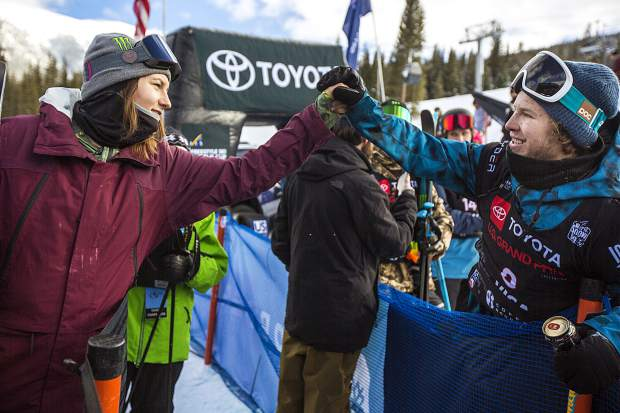 U.S. freeski veteran Devin Logan, of Vermont, high fives Aaron Blunck, of Crested Butte, following the halfpipe finals at the Toyota U.S. Grand Prix World Cup event on Friday, Dec. 7, at Copper Mountain Resort. Blunck placed first with a high score of 96.25.