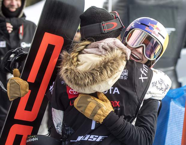 Toby Miller, of California, hugs U.S. teammate Chloe Kim following the Toyota U.S. Grand Prix World Cup halfpipe snowboard men's finals on Saturday, Dec. 8, at Copper Mountain Resort.