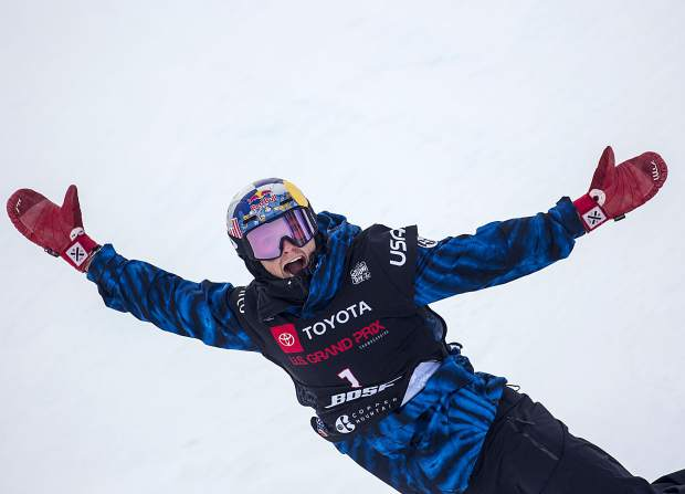 Scotty James, of Australia, reacts after getting the highest score of his last run in the Toyota U.S. Grand Prix World Cup halfpipe snowboard men's finals Saturday, Dec. 8, at Copper Mountain. James placed first with a high of 96.75.