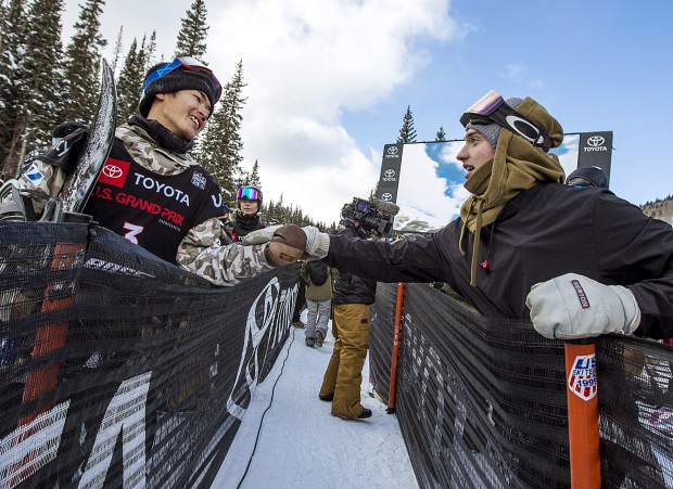 Eagle resident Jake Pates, right, greets Raibu Katayama, of Japan, at the Toyota U.S. Grand Prix World Cup halfpipe snowboard men's finals Saturday, Dec. 8, at Copper Mountain.